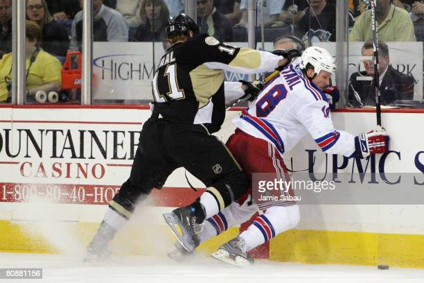 Jordan Staal of the Pittsburgh Penguins checks his brother Marc Staal of the New York Rangers off the puck during game two of the Eastern Conference...