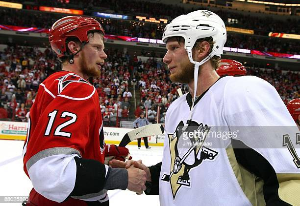 Jordan Staal of the Pittsburgh Penguins is congratulated by his brother Eric Staal of the Carolina Hurricanes after their 4-1 win in Game Four of the...