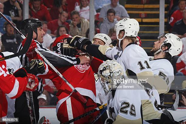 Jordan Staal of the Pittsburgh Penguins puts his glove in the face of Mikeal Samuelsson of the Detroit Red Wings during Game Five of the 2009 NHL...