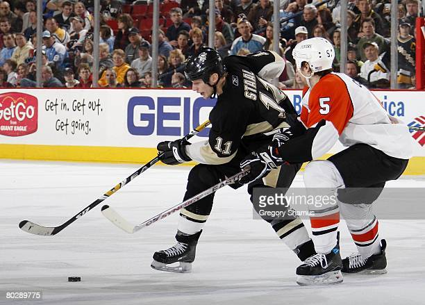 Jordan Staal of the Pittsburgh Penguins tries to control the puck in front of Braydon Coburn of the Philadelphia Flyers on March 16 2008 at Mellon...