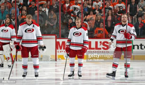 Jordan Staal Teuvo Teravainen and Bryan Bickell of the Carolina Hurricanes stand on the blue line during the National Anthem prior to the start of...