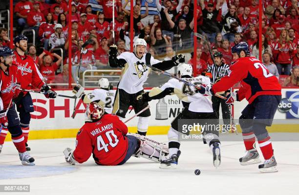 Jordan Staal Tyler Kennedy and Matt Cooke of the Pittsburgh Penguins all celebrate Cooke's go ahead goal in the third period against Simeon Varlamov...