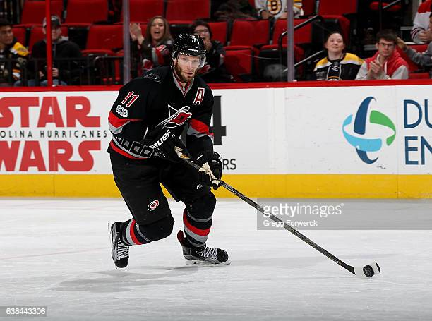 Jordan Stall of the Carolina Hurricanes controls the puck on the ice during an NHL game against the Boston Bruins on January 8 2017 at PNC Arena in...