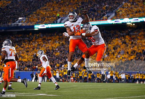 Jordan Sterns of the Oklahoma State Cowboys celebrates after recovering a fumble by Rushel Shell of the West Virginia Mountaineers in the first half...