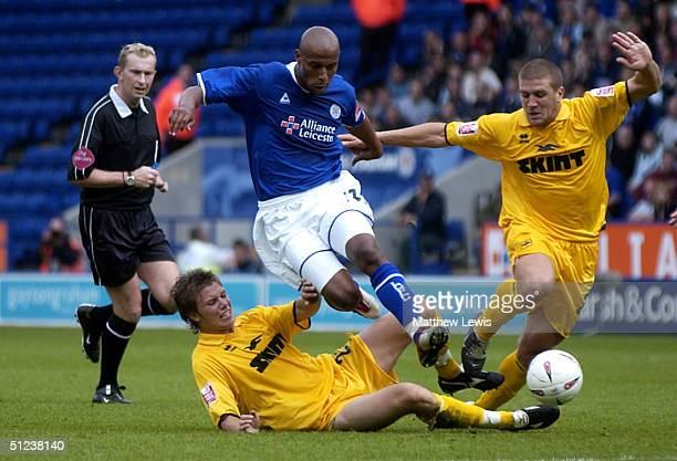 Jordan Stewart of Leicester is tackled by Dean Hammond of Brighton during the CocaCola Championship match between Leicester City and Brighton and...