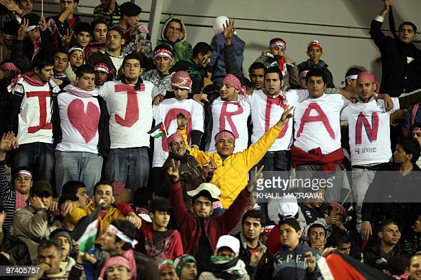 Jordan supporters cheer their team during their 2011 AFC Asian Cup Group E qualifying football match against Singapore in Amman on March 3 2010...