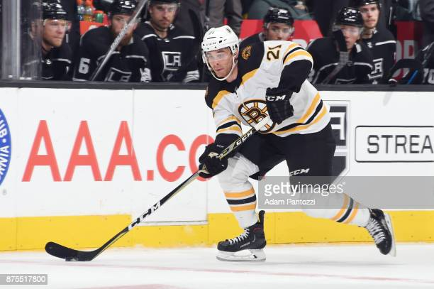 Jordan Szwarz of the Boston Bruins handles the puck during a game against the Los Angeles Kings at STAPLES Center on November 16 2017 in Los Angeles...