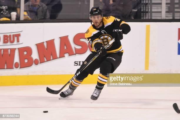 Jordan Szwarz of the Boston Bruins passes the puck against the Toronto Maple Leafs at the TD Garden on November 11 2017 in Boston Massachusetts