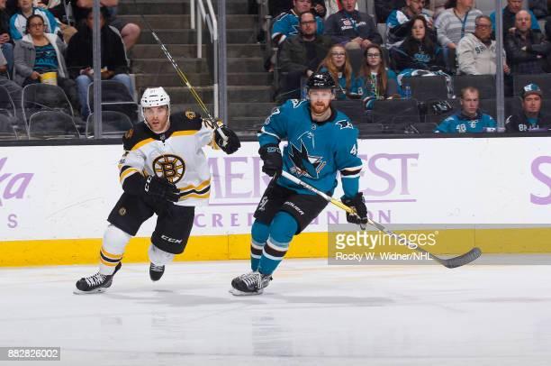 Jordan Szwarz of the Boston Bruins skates against Joakim Ryan of the San Jose Sharks at SAP Center on November 18 2017 in San Jose California