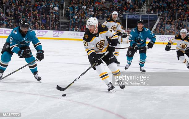 Jordan Szwarz of the Boston Bruins skates with the puck against Joel Ward of the San Jose Sharks at SAP Center on November 18 2017 in San Jose...