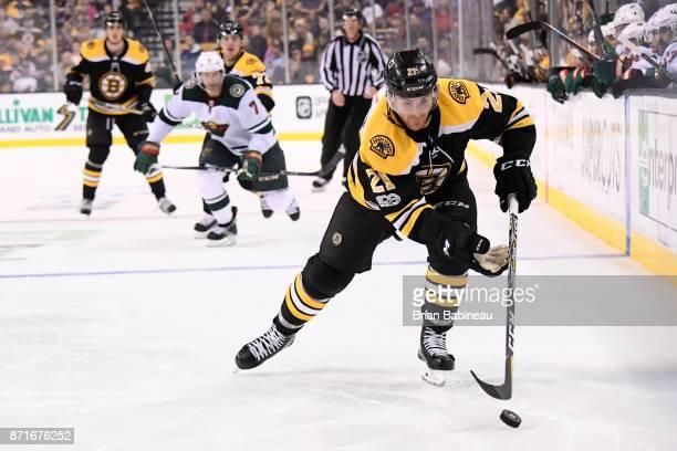 Jordan Szwarz of the Boston Bruins skates with the puck against the Minnesota Wild at the TD Garden on November 6 2017 in Boston Massachusetts