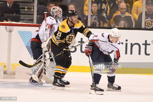 Jordan Szwarz of the Boston Bruins watches the play against Braden Holtby and Dmitry Orlov of the Washington Capitals at the TD Garden on November 4...