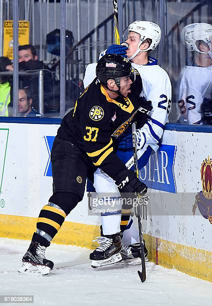 Jordan Szwarz of the Providence Bruins puts a hit on Kasperi Kapanen of the Toronto Marlies during game action on October 26 2016 at Ricoh Coliseum...