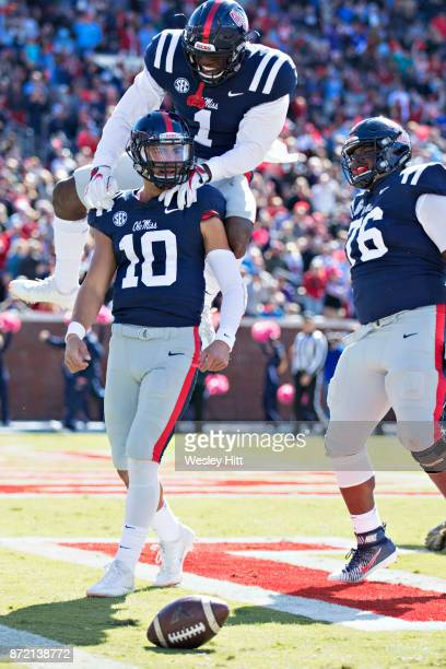 Jordan Ta'amu AJ Brown and Daronte Bouldin of the Ole Miss Rebels celebrate after scoring a touchdown during a game against the Arkansas Razorbacks...