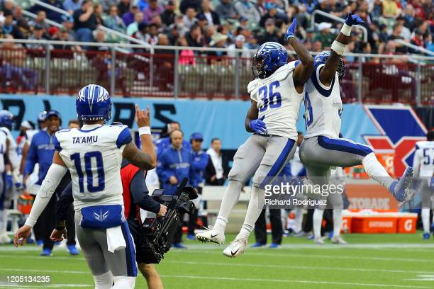 Jordan Ta'amu Keith Ford and Christine Michael of the St Louis Battlehawks celebrate a secondquarter touchdown against the Dallas Renegades during an...