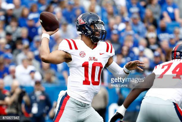 Jordan Ta'amu of the Mississippi Rebels throws a pass against the Kentucky Wildcats at Commonwealth Stadium on November 4 2017 in Lexington Kentucky