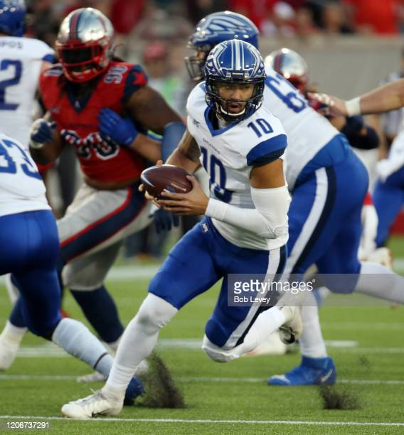 Jordan Ta'amu of the St Louis Battlehawks rolls out of the pocket against the Houston Roughnecks at TDECU Stadium on February 16 2020 in Houston Texas
