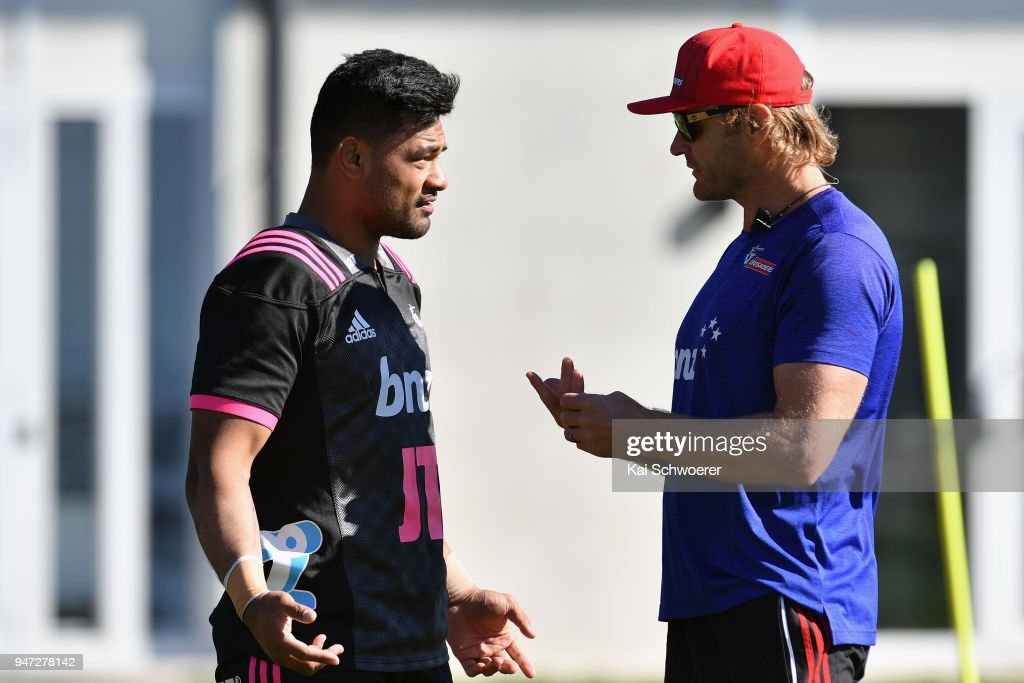 Jordan Taufua and Head Coach Scott Robertson (L-R) react during a Crusaders Super Rugby training session at Rugby Park on April 17, 2018 in Christchurch, New Zealand.