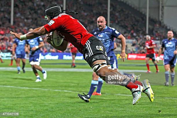 Jordan Taufua of the Crusaders dives over to score a try during the round 11 Super Rugby match between the Crusaders and the Blues at AMI Stadium on...