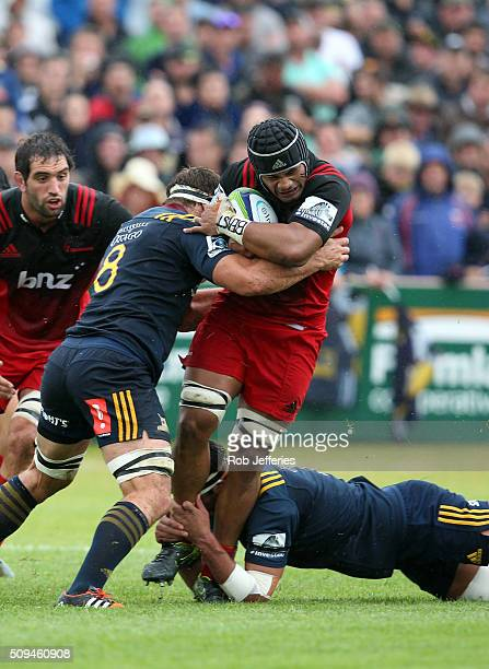 Jordan Taufua of the Crusaders is hit hard in the tackle by Luke Whitelock of the Highlanders during the Super Rugby trial match between the...