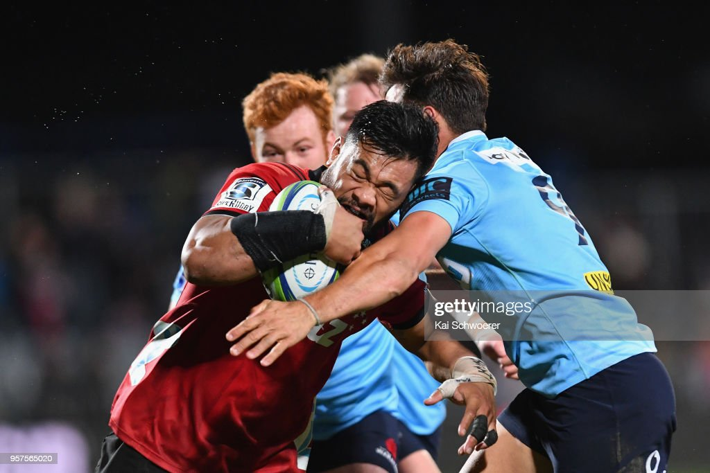 Jordan Taufua of the Crusaders is tackled by Nick Phipps of the Waratahs during the round 12 Super Rugby match between the Crusaders and the Waratahs at AMI Stadium on May 12, 2018 in Christchurch, New Zealand.