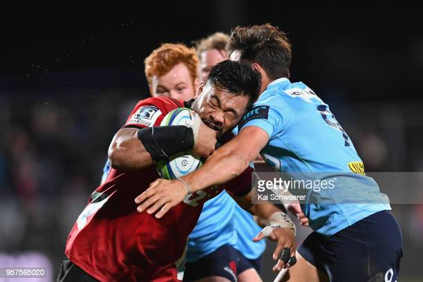 Jordan Taufua of the Crusaders is tackled by Nick Phipps of the Waratahs during the round 12 Super Rugby match between the Crusaders and the Waratahs...