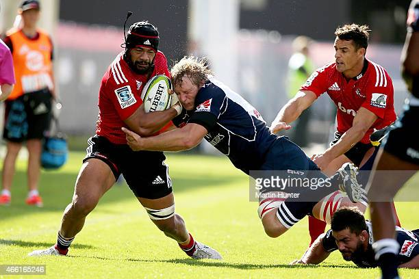 Jordan Taufua of the Crusaders is tackled during the round five Super Rugby match between the Crusaders and the Lions at AMI Stadium on March 14 2015...