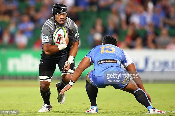 Jordan Taufua of the Crusaders looks to avoid being tackled by Ben Tapuai of the Force during the round seven Super Rugby match between the Force and...