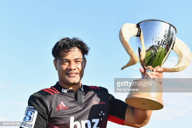 Jordan Taufua of the Crusaders presents the Farmlands Cup following the preseason Super Rugby match between the Crusaders and the Highlanders on...