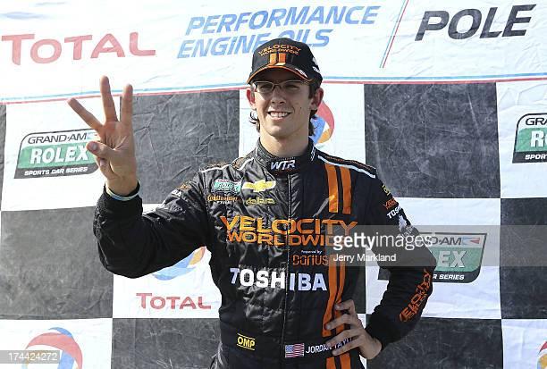 Jordan Taylor codriver of the Wayne Taylor Racing Velocity Worldwide/Toshiba/Chevrolet Corvette DP clebrates winning the pole for the Brickyard Grand...