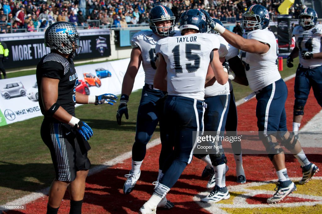 Jordan Taylor #15 of the Rice Owls celebrates with teammates after a touchdown against the Air Force Falcons on December 29, 2012 during the Bell Helicopter Armed Forces Bowl at Amon G. Carter Stadium in Fort Worth, Texas.