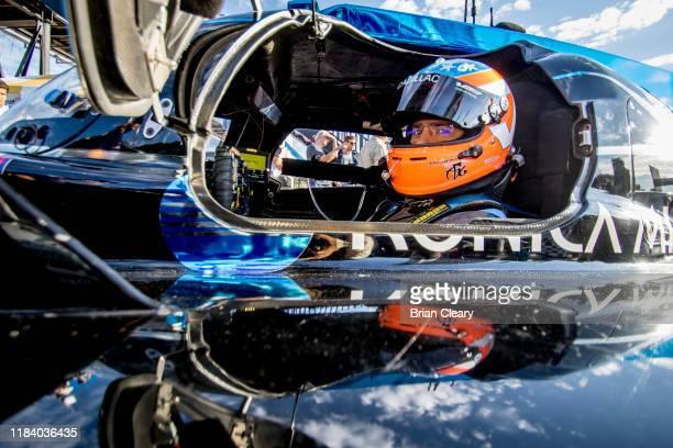 Jordan Taylor sits in his car before the Petit Le Mans, IMSA WeatherTech Series race at Michelin Raceway Road Atlanta, October 12, 2019 in Braselton,...