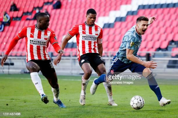 Jordan Teze of PSV, Denzel Dumfries of PSV, Dusan Tadic of Ajax during the Dutch Eredivisie match between PSV v Ajax at the Philips Stadium on...
