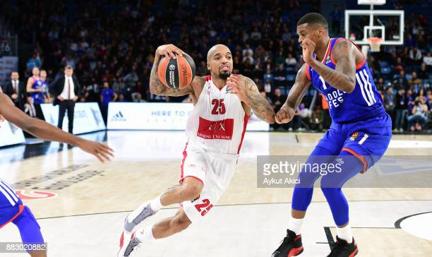 Jordan Theodore #25 of AX Armani Exchange Olimpia Milan competes with competes with Ricky Ledo #1 of Anadolu Efes Istanbul during the 2017/2018...