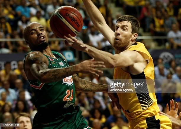 Jordan Theodore of Banvit in action against Fran Vazquez of Iberostar Tenerife during the FIBA Champions League final match between Iberostar...