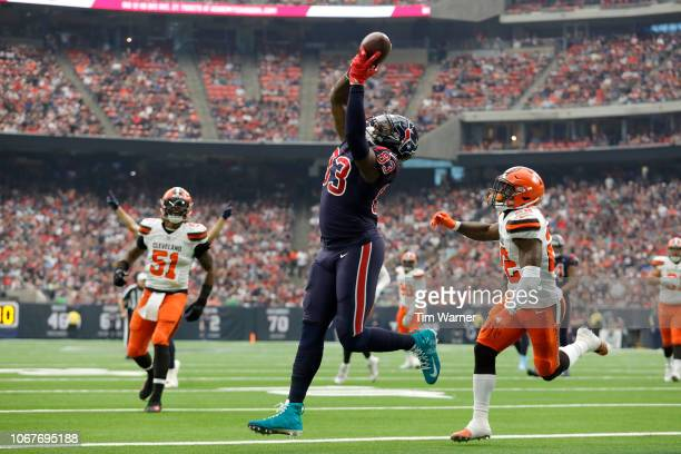 Jordan Thomas of the Houston Texans catches a touchdown pass defended by Jabrill Peppers of the Cleveland Browns in the first quarter at NRG Stadium...