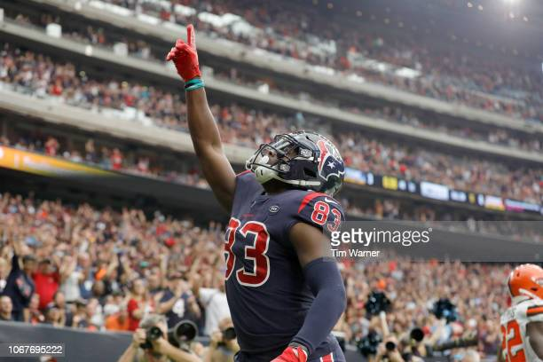Jordan Thomas of the Houston Texans celebrates a touchdown reception against the Cleveland Browns in the first quarter at NRG Stadium on December 2...