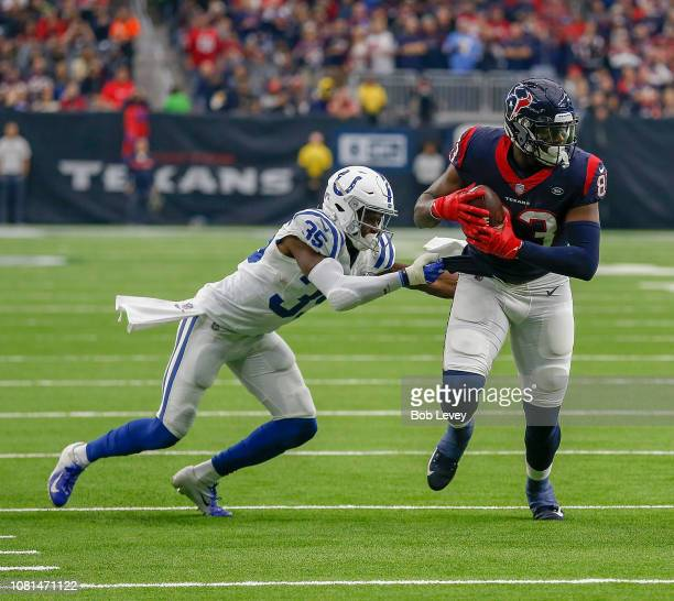 Jordan Thomas of the Houston Texans fends off Pierre Desir of the Indianapolis Colts at NRG Stadium on December 9, 2018 in Houston, Texas.