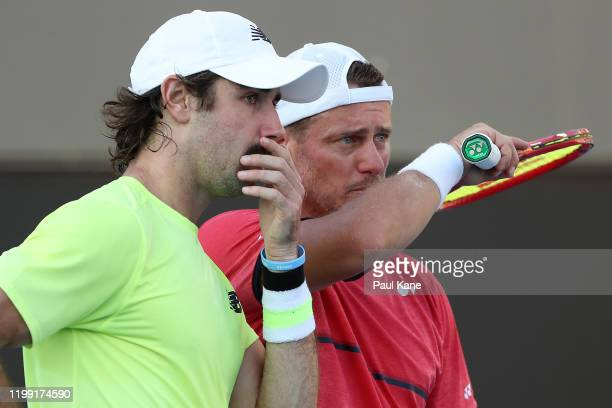 Jordan Thompson and Lleyton Hewitt of Australia talk during their doubles match against Cristian Garin of Chile and Juan Ignacio Londero of Argentina...