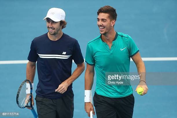 Jordan Thompson and Thanasi Kokkinakis of Australia celebrate a point during their doubles match against Daniel Nestor and Edouard RogerVasselin...