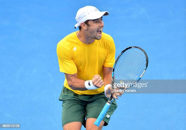Jordan Thompson of Australia celebrates winning a point in his match against Jack Sock of the USA during the Davis Cup World Group Quarterfinals...