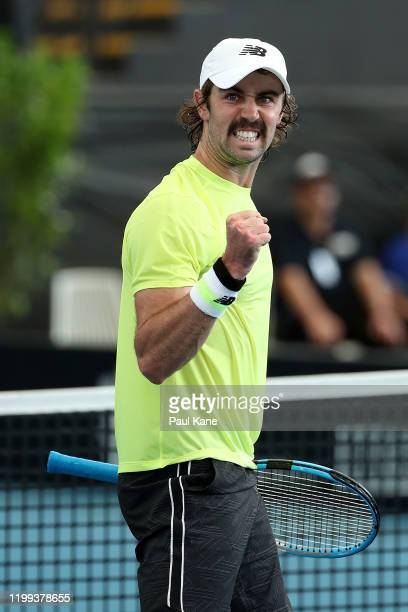 Jordan Thompson of Australia celebrates winning the second set in his singles match against Albert RamosVinolas of Spain during day three of the 2020...