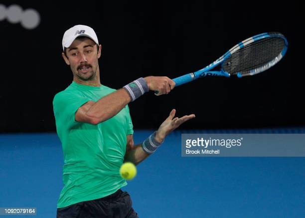 Jordan Thompson of Australia hits a return during his match with Alex De Minaur of Australia during day five of the 2019 Sydney International at the...