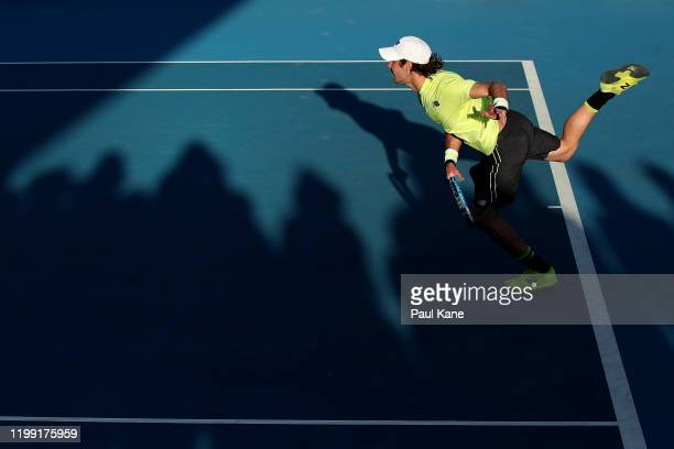 Jordan Thompson of Australia partnered Lleyton Hewitt serves in the doubles match against Cristian Garin of Chile and Juan Ignacio Londero of...