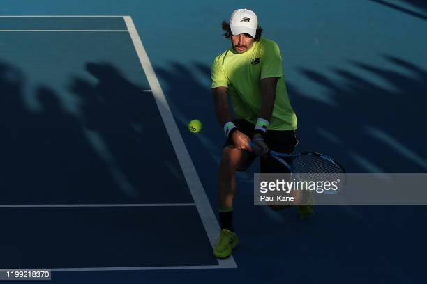 Jordan Thompson of Australia partnered with Lleyton Hewitt plays a backhand in the doubles match against Cristian Garin of Chile and Juan Ignacio...