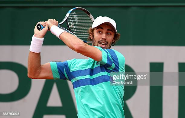 Jordan Thompson of Australia plays a backhand during the Men's Singles first round match against Laslo Djere of Serbia on day two of the 2016 French...