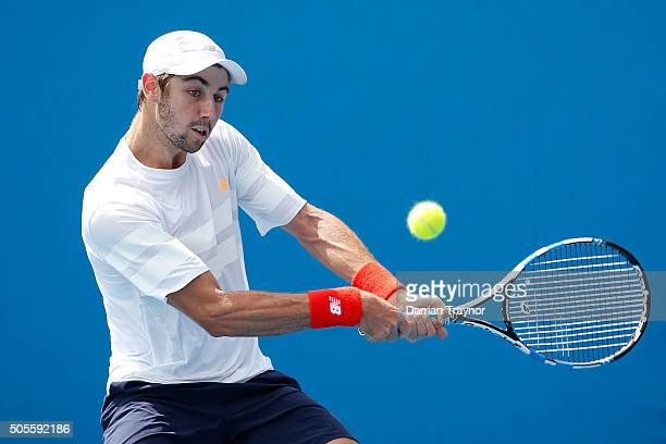 Jordan Thompson of Australia plays a backhand in his first round match against Thomaz Bellucci of Brazil during day two of the 2016 Australian Open...