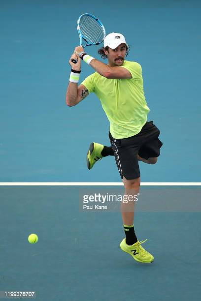 Jordan Thompson of Australia plays a backhand to Albert RamosVinolas of Spain during day three of the 2020 Adelaide International at Memorial Drive...