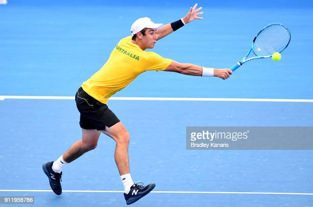 Jordan Thompson of Australia plays a backhand volley during a practice session ahead of the Davis Cup World Group First Round tie between Australia...