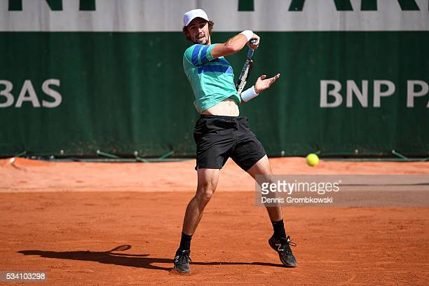 Jordan Thompson of Australia plays a forehand during the Men's Singles second round match against Ivo Karlovic of Croatia at Roland Garros on May 25...